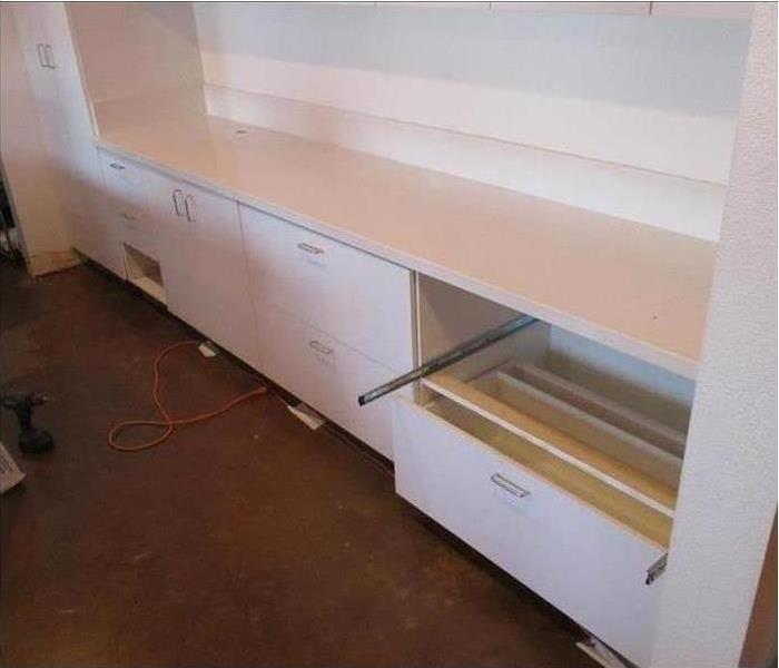 Fixed white cabinets